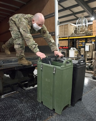 Tech. Sgt. Eric Lengle loads drink containers onto a truck while preparing to deploy in support of service members in the D.C. area for the 59th Presidential Inauguration.