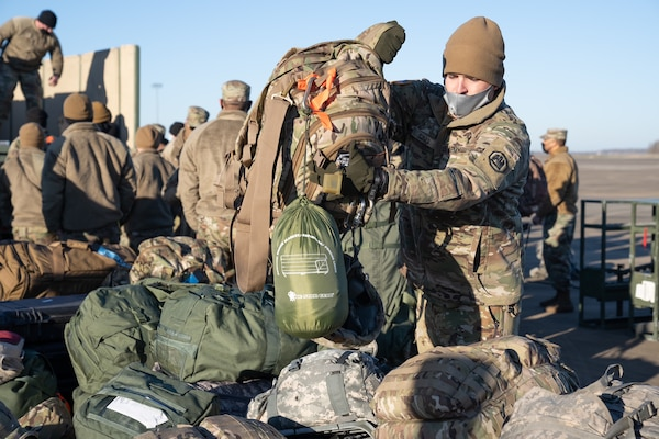 Louisiana National Guard Soldiers and Airmen from throughout the state prep their gear and board planes at Alexandria Airport in Alexandria, Louisiana, en route to Washington, D.C., Jan. 16, 2021. They will assist the District of Columbia National Guard to ensure a safe presidential inauguration.
