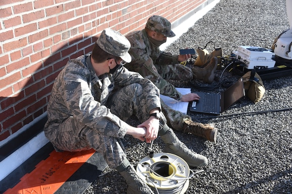 Members of the 111th Attack Wing Communications Squadron and the 271st Combat Communications Squadron, Horsham Air Guard Station, Pa., begin the procedure of setting up satellite communications at the District of Colombia National Guard's Joint Force Headquarters in Washington, D.C., on Jan. 10, 2021, while supporting Operation Capitol Response-PA.