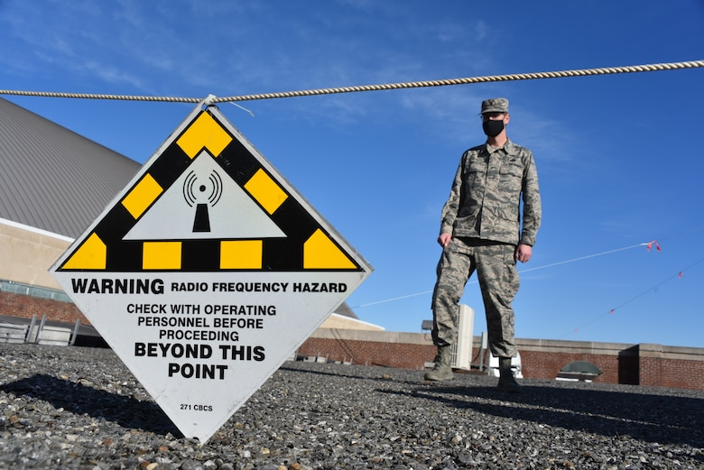 1st Lt Howard Chattley of the 111th Attack Wing Communications Flight, Pennsylvania Air National Guard, from Horsham Air Guard Station, Pa., sets up a safe RF Hazard perimeter while setting up satellite communications equipment on Jan. 10, 2021, in Washington, D.C., while supporting Operation Capitol Response-PA.