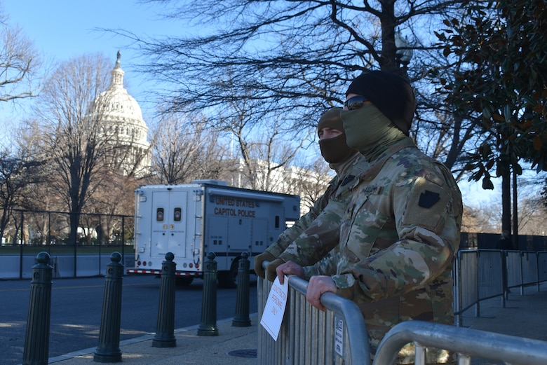 Sgt. Joshua Zook, right, and Spc. Kenneth Steinly from the 2nd Squadron, 104th Cavalry Regiment, 56th Stryker Brigade Combat Team, Pennsylvania Army National Guard stand guard in Washington, D.C., on Jan. 10, 2021.