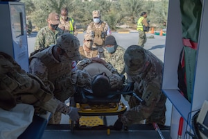 210113-N-KZ419-1386 U.S. 5TH FLEET AREA OF OPERATIONS (Jan. 13, 2021) Bahrain Defense Force and U.S. Naval Forces Central Command personnel transport a simulated medical casualty during in a joint anti-terrorism and mass casualty exercise in the U.S. 5th Fleet Area of Operations, Jan. 13. The bilateral exercise focused on enhancing mutual security and anti-terrorism capabilities by testing responses to simulated scenarios.  (U.S. Navy photo by Mass Communication Specialist 3rd Class Dawson Roth)
