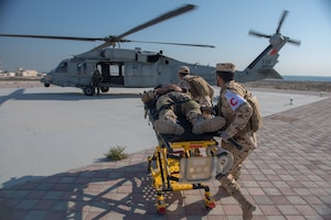 210113-N-KZ419-1438 U.S. 5TH FLEET AREA OF OPERATIONS (Jan. 13, 2021) Bahrain Defense Force personnel transport a simulated medical casualty during in a joint anti-terrorism and mass casualty exercise with U.S. Naval Forces Central Command in the U.S. 5th Fleet Area of Operations, Jan. 13. The bilateral exercise focused on enhancing mutual security and anti-terrorism capabilities by testing responses to simulated scenarios. (U.S. Navy photo by Mass Communication Specialist 3rd Class Dawson Roth)