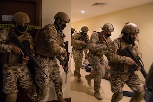 210113-N-YD651-1054 5TH FLEET AREA OF OPERATIONS (Jan. 13, 2021) Bahrain Defense Force and U.S. Naval Forces Central Command personnel simulate clearing a building during a joint anti-terrorism exercise in the U.S. 5th Fleet Area of Operations, Jan. 13. The bilateral exercise focused on enhancing mutual security and anti-terrorism capabilities by testing responses to simulated scenarios. (U.S. Navy photo by Mass Communication Specialist 2nd Class Matthew Riggs)
