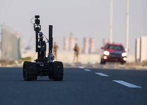 210113-N-KZ419-1087 U.S. 5TH FLEET AREA OF OPERATIONS (Jan. 13, 2021) Bahrain Defense Force explosive ordnance disposal technicians control a robot to investigate a simulated improvised explosive device during a joint anti-terrorism exercise with U.S. Naval Forces Central Command in the U.S. 5th Fleet area of operations, Jan. 13. The bilateral exercise focused on enhancing mutual security and anti-terrorism capabilities by testing responses to simulated scenarios. (U.S. Navy photo by Mass Communication Specialist Dawson 3rd Class Roth)
