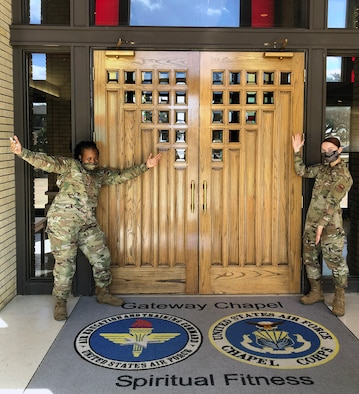 Senior Airman Tamera Fowler (left) and Senior Airman Lillian Griffith (right), Religious Affairs Airmen at Joint Base San Antonio-Lackland, stand at the main entrance to the Gateway Chapel. The Airmen will answer questions from potential Air and Space Force enlistees during an Air Force Recruiting Service social media chat session Jan. 27, 2021.
