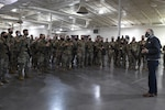 Gov. Jay Inslee speaks to members of the Washington National Guard Jan., 17, 2021, at Joint Base Lewis-McChord, Wash., before their departure to Washington, D.C., to support the presidential inauguration. They are among 25,000 Guard members who are in the District of Columbia from all 50 states, three territories and D.C.