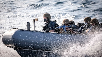 Sailors conduct visit, board, search and seizure training.