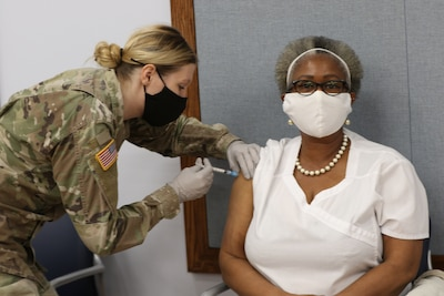 Cynthia Carsice with Tuttle Army Health Center  on Hunter Army Airfield, receives the Moderna COVID-19 Vaccine on Fort Stewart in early January 2021.