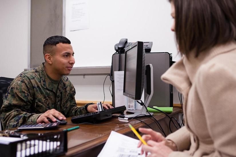 A service member prepares his tax return.