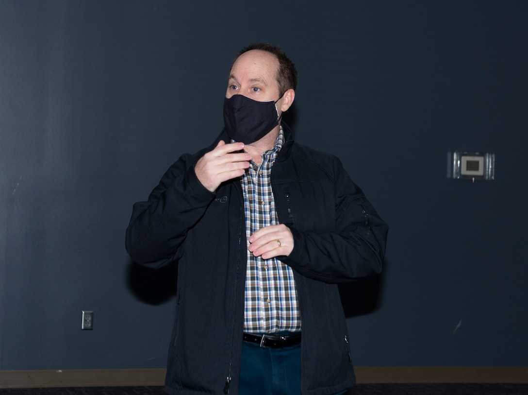 man speaking while wearing face mask