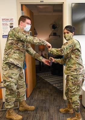 Col. Jenise Carroll cuts the ribbon during a ribbon-cutting ceremony for the opening of the comfort room.