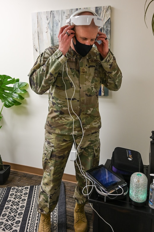 Chief Master Sgt. Christopher Walker tries a guided meditation headset.