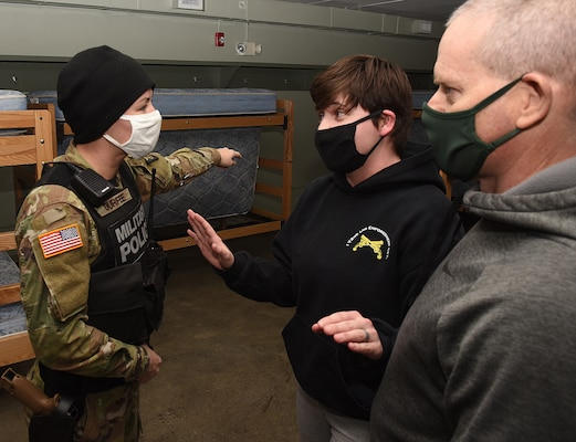 Sgt. Katelyn Durfee attempts to break up an argument during a training exercise at the Camp Ethan Allen Training Site in Jericho, Vermont, on Jan. 16, 2021. Soldiers with the 172nd Law Enforcement Detachment were evaluated on handling domestic disturbances as well as conducting traffic stops and investigating criminal activity. (U.S. Army National Guard photo by Don Branum)