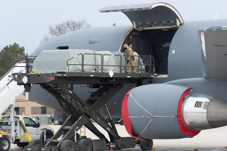 U.S. Air Force Master Sgt. Timothy Dupuis and Tech. Sgt. Sean Avery, both assigned to the 157th Maintenance Group, New Hampshire Air National Guard, load seat pallets onto a KC-46A tanker at Pease Air National Guard Base, New Hampshire, Jan. 14, 2021. The tanker is one of Pease's three jets being used to transport about 500 National Guardsmen from New Hampshire, Oklahoma and Nevada to Washington D.C. to provide security during Inauguration Day Jan. 20. (U.S. Air Force photo by Tech. Sgt. Aaron Vezeau)