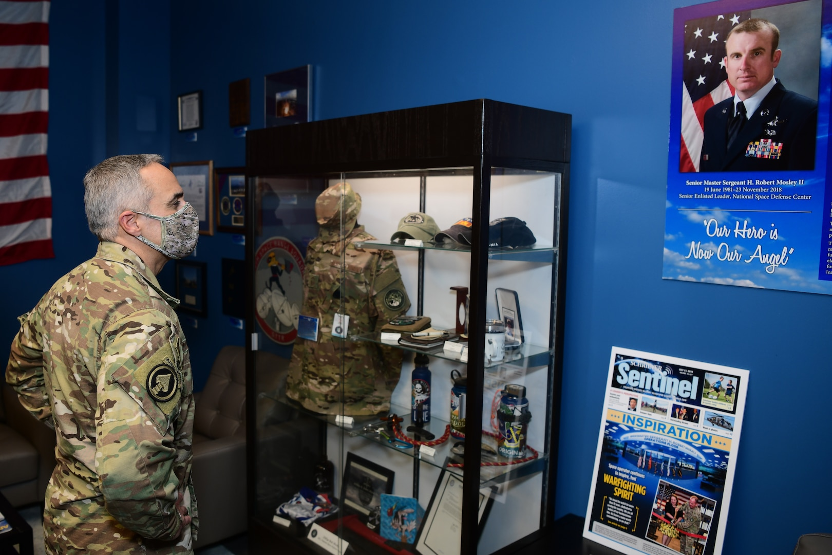 """Senior Enlisted Advisor to the Chairman of the Joint Chiefs of Staff Ramón """"CZ"""" Colón-López views the Senior Master Sgt. Harold Mosely, II library on the National Space Defense Center operations floor at Schriever Air Force Base, Colorado, Jan. 13, 2021."""