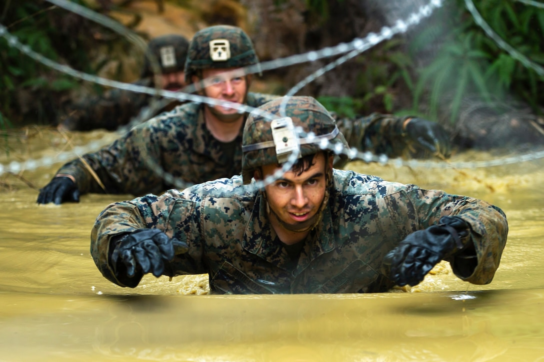 Marines navigate a water obstacle.