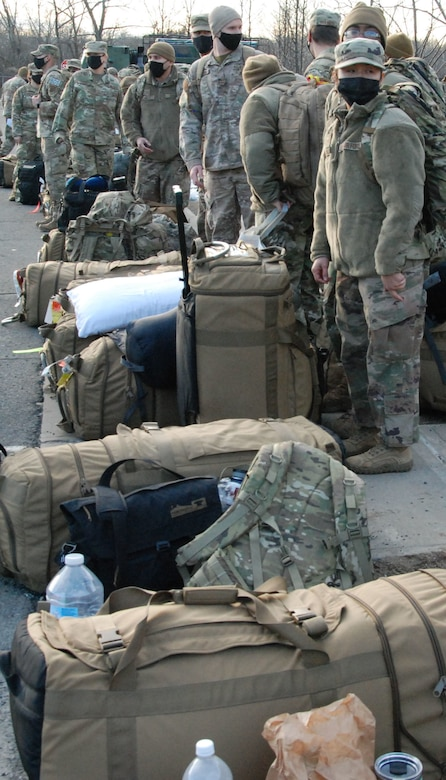 New York Air National Guard Security Forces Airmen board buses at Stewart Air National Guard Base in Newburgh, N.Y. as they deploy to Washington, D.C. on January 8, 2020.