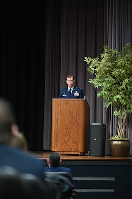 U.S. Air Force Col. James Akers, 1st Operations Group commander at Joint Base Langley-Eustis, Virginia, speaks to the Specialized Undergraduate Pilot Training class 21-04 at their graduation ceremony, Jan. 15, 2020, on Columbus Air Force Base, Miss. The 52-week training consist of six-weeks of preflight academics and physiological training followed by primary training. (U.S. Air Force photo by Airman 1st Class Jessica Haynie)