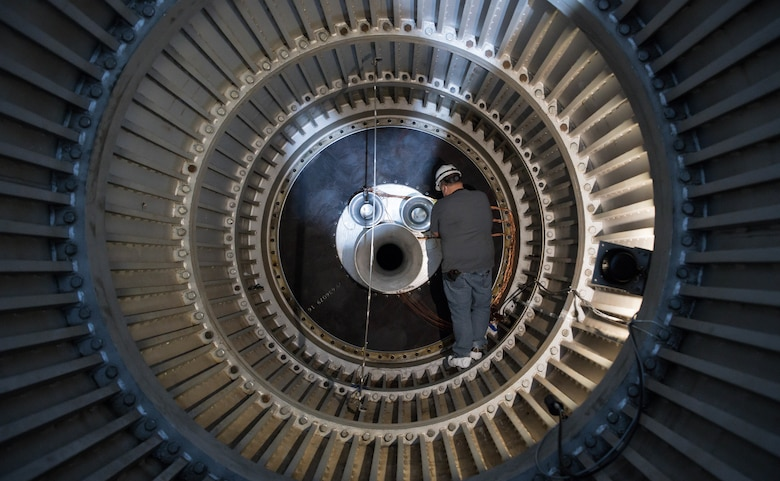 Jay Caldwell, an outside machinist, works on venturis mounted inside the scavenging scoop in the 16-foot supersonic wind tunnel, Nov. 3, 2020, at Arnold Air Force Base, Tenn. The scoop was modified to allow for the calibration of a large-scale mass flow assembly. (U.S. Air Force photo by Jill Pickett)