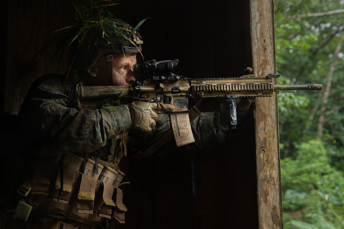 A U.S. Marine provides security during the 3rd Marine Division Rifle Squad Competition at Camp Gonsalves, Japan, Jan. 12.