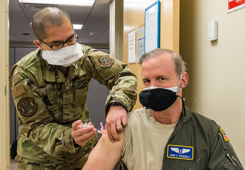 Col. John Rockwell, 436th Medical Group chief of aerospace medicine, is administered the COVID-19 vaccine by Tech. Sgt. Juan Davila, 436th Operational Medical Readiness Squadron flight operational medicine noncommissioned officer in charge, Jan. 15, 2021, at Dover Air Force Base, Delaware. As the 436th Airlift Wing public health emergency officer, Rockwell was among the first Team Dover frontline workers who voluntarily received the vaccine and were identified as eligible in concurrence with Department of Defense guidance. (U.S. Air Force photo by Roland Balik)