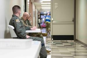 people sit in hallway