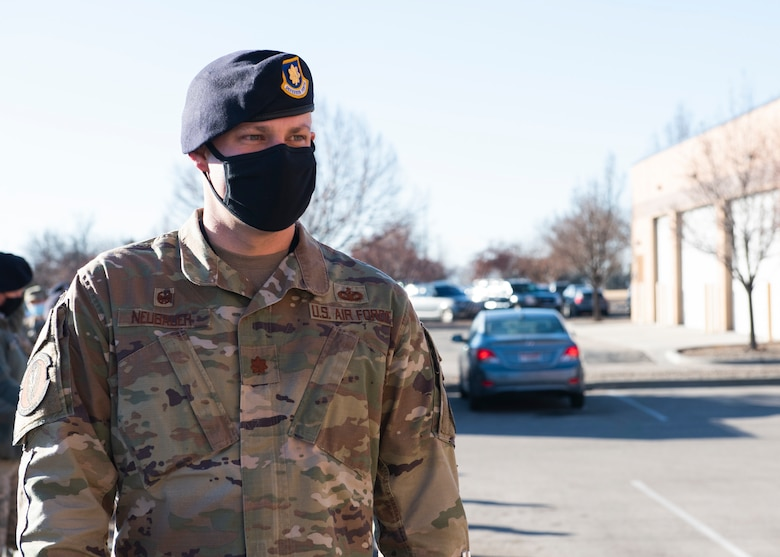 U.S. Air Force Maj. Andrew Neubauer, 366th Security Forces Squadron commander, enters Heritage Hall, at the 366th Medical Treatment Facility, Jan. 19, 2021. Neubauer was the first person to receive the first dose of the COVID-19 vaccine at MHAFB. (U.S. Air Force photo by Airman 1st Class Natalie Rubenak)