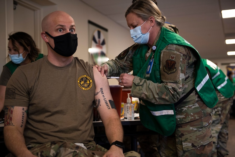U.S. Air Force Maj. Andrew Neubauer, 366th Security Forces Squadron commander, receives the COVID-19 vaccine, at Mountain Home Air Force Base, Idaho, Jan. 19, 2021. MHAFB received a shipment of the vaccines and began administering them the same day. (U.S. Air Force photo by Airman 1st Class Natalie Rubenak)