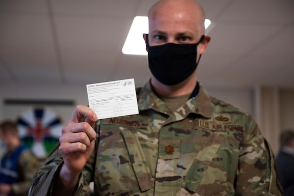 U.S. Air Force Maj. Andrew Neubauer, 366th Security Forces Squadron commander, holds up his COVID-19 vaccination card, at Mountain Home Air Force Base, Idaho, Jan. 19, 2021. Neubauer will receive his second dose of the vaccine in three weeks. (U.S. Air Force photo by Airman 1st Class Natalie Rubenak)