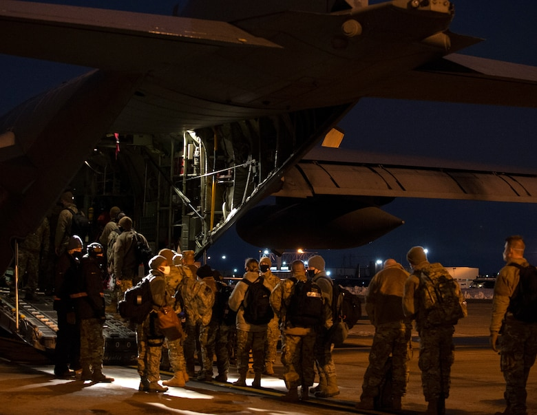 U.S. Air Force Airmen from the 133rd Airlift Wing board a C-130 Hercules in St. Paul, Minn., Jan. 18, 2021.