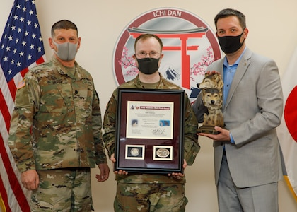 Lt. Col. Matthew Levine, commander of Public Health Activity-Japan, presented representatives of SARS Team Six, Maj. Bradley Kearney, a biochemist and former Public Health Command-Pacific Laboratory Sciences director, and Gary Crispell, a PHC-P microbiologist, the 4th Quarter and Fiscal Year 2020 Wolf Pack Awards for their support as the lead clinical testing team for COVID-19 for U.S. Forces Japan during a virtual ceremony Jan. 20, 2020, at Camp Zama, Japan. The Wolf Pack Award recognizes exceptional teamwork by an integrated group of military and civilian team members focused on excellence in support of Army Medicine. (Photo by Momoko Shindo)
