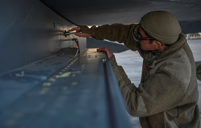 Airman works on aircraft.