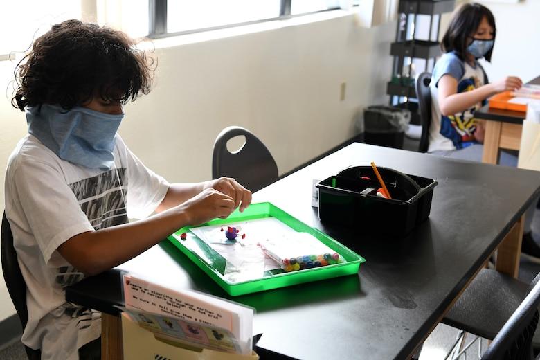 Zechariah Winder and Elise Weisz make virus models out of clay during the Disease Ecology and Viruses STARBASE Vandenberg class Jan. 13, 2021, at Vandenberg Air Force Base, Calif.