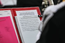 Sheet music for The Washington Post March and The Stars and Stripes Forever rests on the stand of a Marine Band musican during the 2021 Inauguration Ceremony.  (U.S. Marine Corps photo by Staff Sgt. Chase Baran/released)