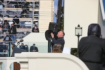 """Garth Brooks performes """"Amazing Grace"""" during the 2021 Inauguration Ceremony. Marine Band trumpeter Master Gunnery Sgt. Matthew Harding provided accompaniment during the performance.  (U.S. Marine Corps photo by Master Gunnery Sgt. Amanda Simmons/released)"""