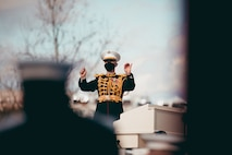 """Col. Jason K. Fettig directs """"The President's Own"""" United States Marine Band during the 59th Inaugural Ceremony for President Joe Biden.  (U.S. Marine Corps photo by Staff Sgt. Christian Thesken/released)"""