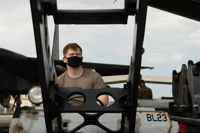 U.S. Air Force Senior Airman John Whitaker, a weapons load crew member, from the 67th Aircraft Maintenance Unit, competes in the quarterly load competition at Kadena Air Base, Japan, Jan. 15, 2021. The 67th AMU won the quarterly load competition against the 44th AMU. (U.S. Air Force photo by Airman First Class Stephen Pulter)