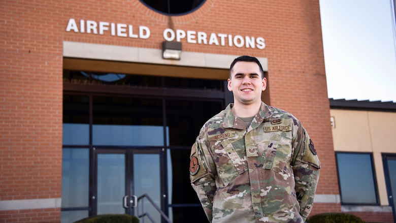 Staff Sgt. Robert Moreno stands in front of the Air Operations Complex at Sheppard Air Force Base