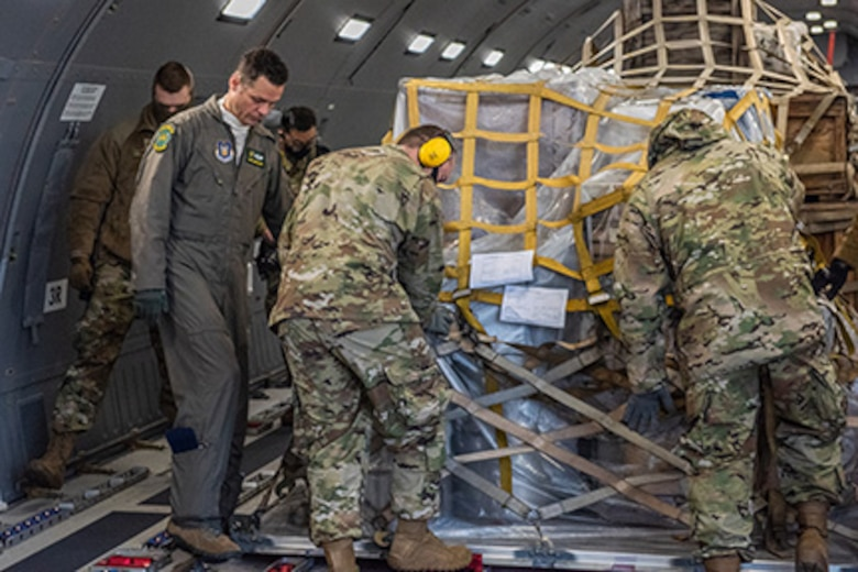 Tech. Sgt. Chris Davis, a boom operator from the 916th Air Refueling Wing, assists 67th Aerial Port Squadron reservists with locking a pallet down in a KC-46A Pegasus, Jan. 10, 2021, at Hill Air Force Base, Utah.