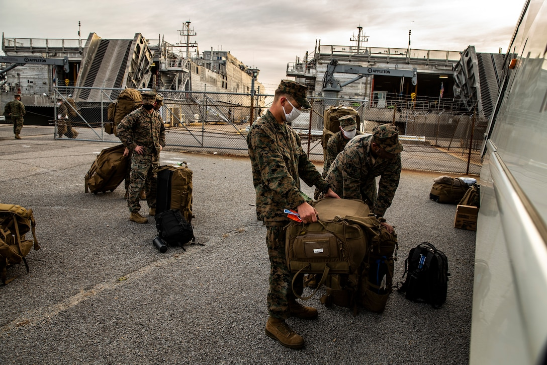 U.S. Marines load gear into a bus at Joint Expeditionary Base Little Creek-Fort Story, Va., Dec. 28.