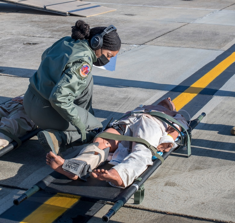 """Capt. Toya Williams, 36th Aeromedical Evacuation Squadron flight nurse, tends to a """"patient"""" during aeromedical evacuation training at Keesler Air Force Base, Miss., Jan. 13, 2021. Williams is a traditional reservist who, in the civilian world, works as a travel nurse based out of Los Angeles. (U.S. Air Force photo by Senior Airman Kristen Pittman)"""