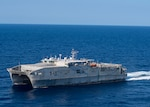 The expeditionary fast transport USNS Trenton (T-EPF 5) participates in a photo exercise with the expeditionary sea base Hershel