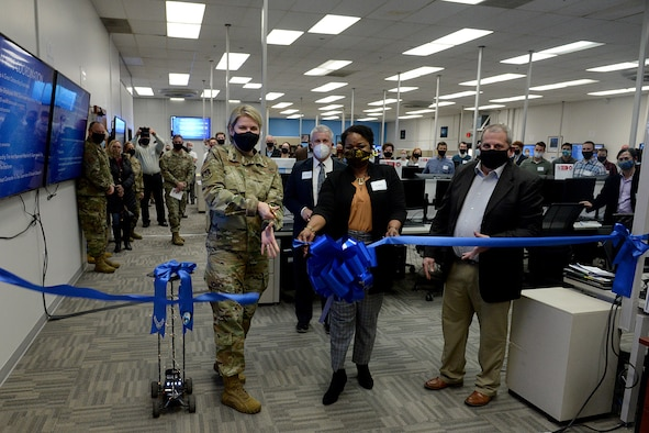 (Left to right) Brig. Gen. Cauley von Hoffman, Ogden Air Logistics Complex commander, Karen Fairclough, Software Organizational Development Office section chief, and Jim Diamond, 309th Software Engineering Group director, cutting the ribbon.