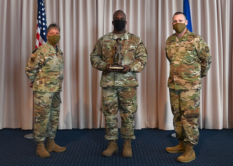 Col. Katrina Stephens, 66th Air Base Group commander, and Chief Master Sgt. Bill Hebb, 66 ABG command chief, present Master Sgt. Ronald Young, 66 ABG Inspector General superintendent, with the 2020 Senior Noncommissioned Officer of the Year award at Hanscom Air Force Base, Mass., Jan 20.