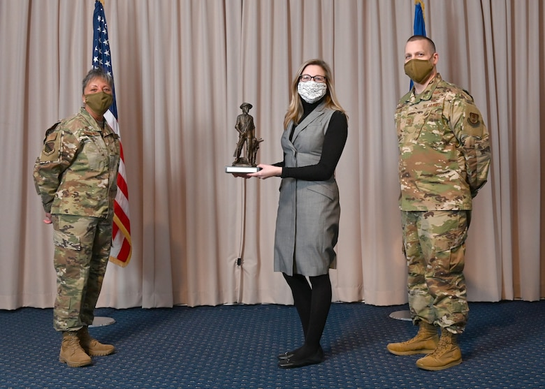 Col. Katrina Stephens, 66th Air Base Group commander, and Chief Master Sgt. Bill Hebb, 66 ABG command chief, Rachel C. D'Orazio, 66th Air Base Group Staff Judge Advocate, with the 2020 Civilian Category 3 of the Year at Hanscom Air Force Base, Mass., Jan 20.