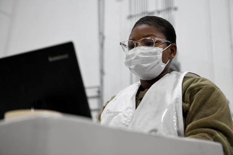 An Airman works at a computer.