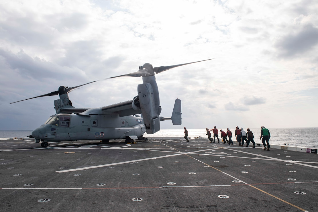 Flight deck personnel unload cargo from an MV-22 Osprey tiltrotor aircraft assigned to Marine Medium Tiltrotor Squadron (VMM) 262 aboard amphibious transport dock ship USS New Orleans (LPD 18).