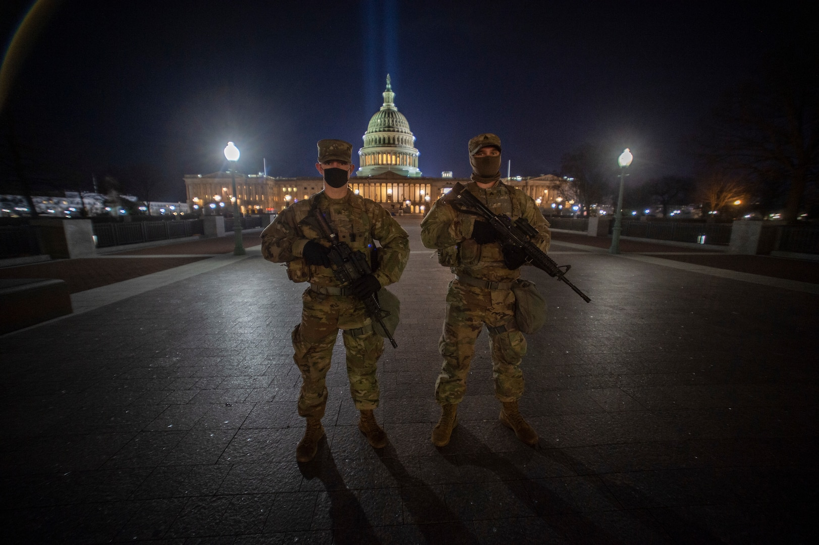 Oklahoma Army National Guard members and brothers Sgt. Kade Silvers, right, and Sgt. Korbin Silvers, both of Enid, Oklahoma, pose at the U.S. Capitol building before beginning their shift monitoring the inner ring of security around the Capitol, Jan. 19, 2021. At least 25,000 National Guard men and women have been authorized to conduct security, communication and logistical missions in support of federal and District authorities leading up to and through the 59th Presidential Inauguration. (U.S. National Guard photo by Sgt. Anthony Jones)