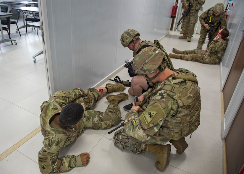 1st. Lt. Matthew Perry, Spc. Brandon Brooks and Spc. Geovanna Mizquez, 1-35th Armored Regiment, render aide to Soldiers injured during Active Shooter exercise at the Joint Training Center in Jordan, Dec. 16, 2020. The purpose of the exercise was to validate the readiness of the JTC emergency response staff, and test how they respond to an active shooter event on post with multiple injuries and mass casualties, known as a MASCAL. (U.S. Army photo by Staff Sgt. Mark Scovell)